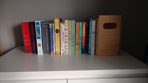A few of those books sitting on an overflow shelf